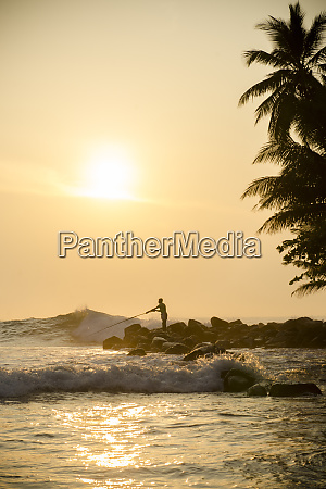 fisherman on talalla beach sri lanka