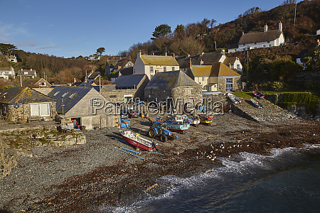 fishing boats pulled up on the