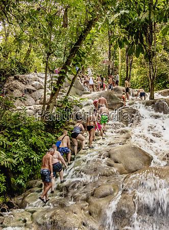 people climbing dunns river falls ocho