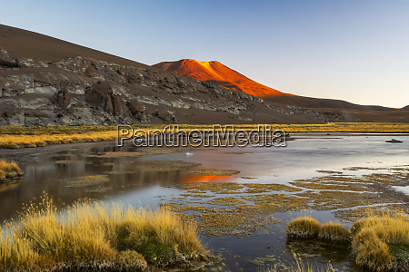 small desert lake at sunset with