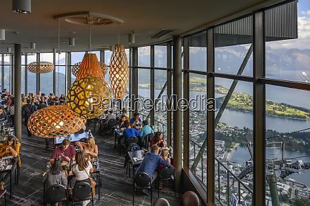 restaurant with glass walls overlooking lake