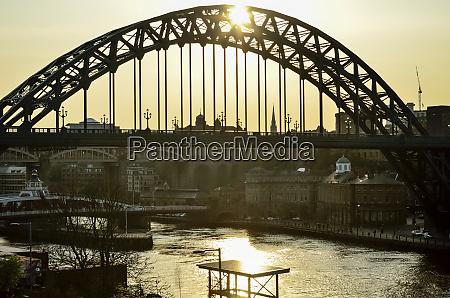 iron bridge at sunset with river