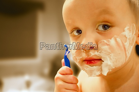 young child shaving