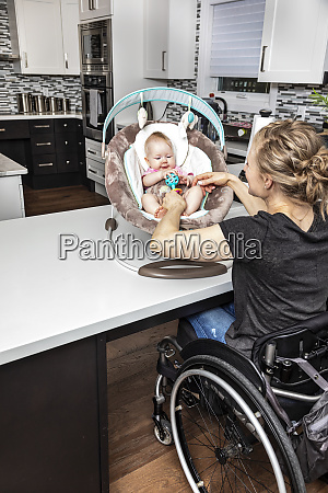 a paraplegic mother in a wheelchair