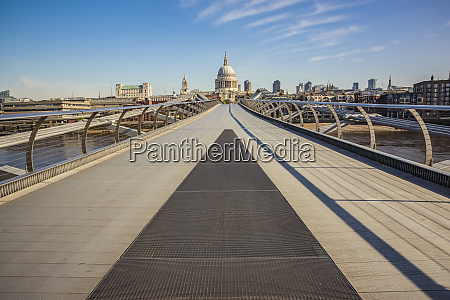 millennium bridge at morning rush hour