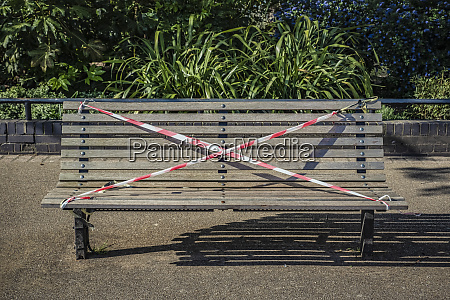 a park bench is roped off