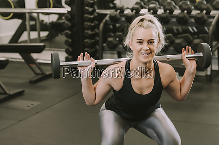 woman working out with weights wellington