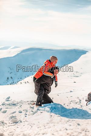 a man wearing a ski suit