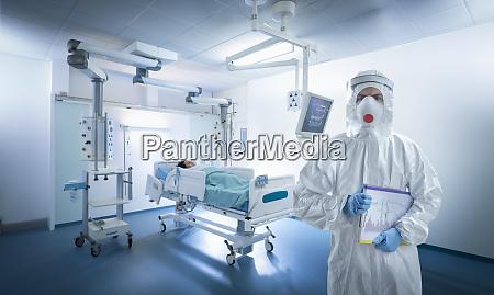 nurse wearing protective gear in icu