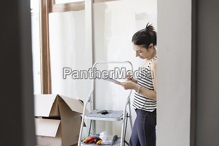 woman looking at a pad of