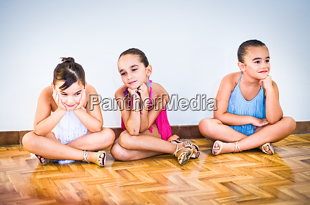 three young girls at dance class