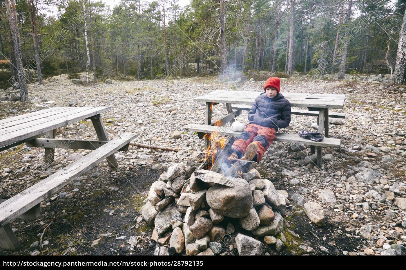 boy, sitting, on, picnic, bench, next - 28792135