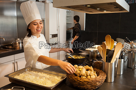 female chef wearing chefs hat standing