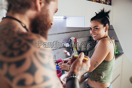 bearded tattooed man with long brunette