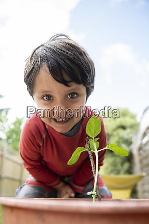 a young boy in a garden