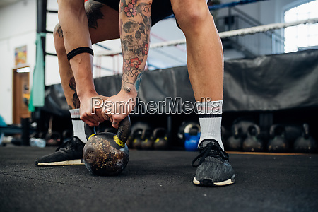 tattooed arms and legs of a