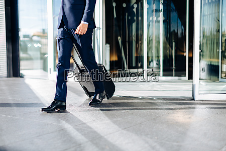 low section of businessman walking with