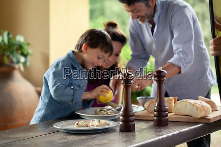 father preparing food with son and