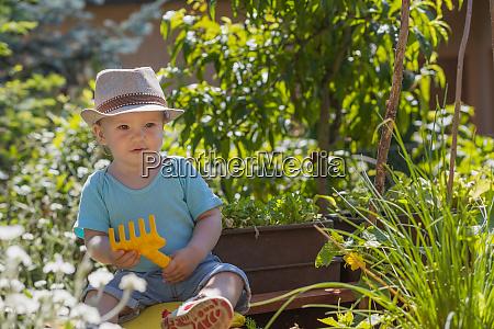 baby boy is showing baby rake