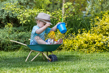 cute baby boy is sitting on