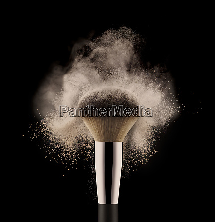 close up of cosmetic powder brush
