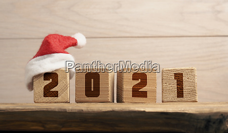 hat of santa on a wooden