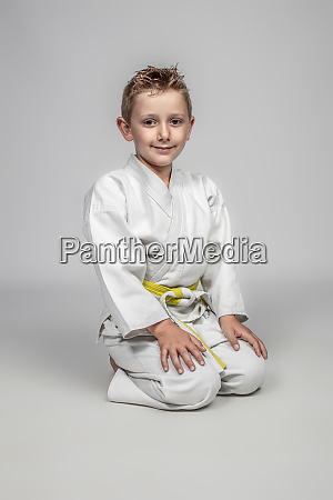 martial arts practitioner sitting in the