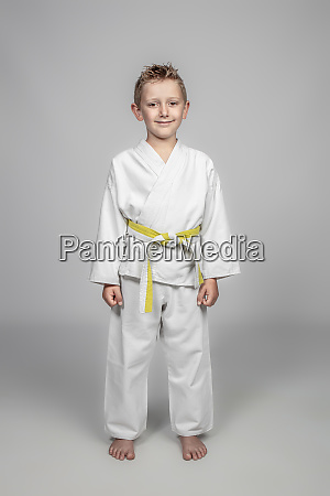 child with kimono standing martial arts