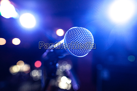 round microphone in the rays of