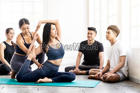 asian yoga coach tarining to yoga