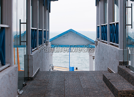 image of empty seafront restaurant