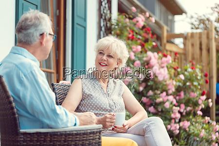 senior couple enjoying their coffee on