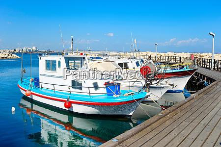 white motorboats marina pier cyprus