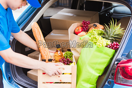 delivery man grocery prepare fresh vegetables