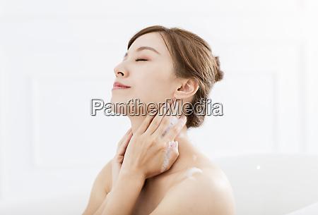 young woman take a bath