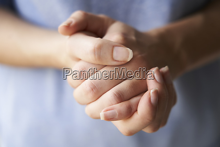 rubbing hands together