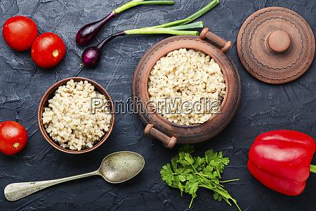 boiled, pearl, barley, on, plate - 28806051