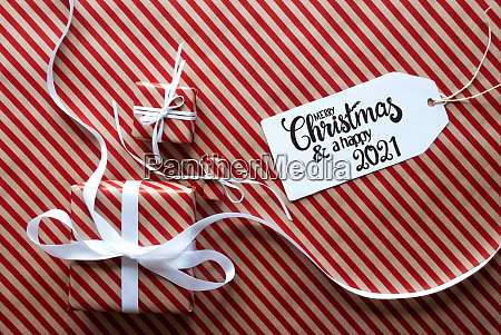 three gifts wrapping paper label merry