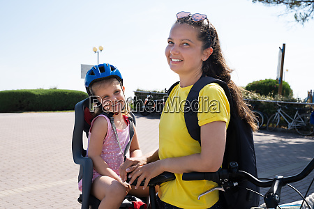 mother riding bicycle outside