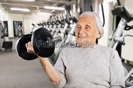 strong retired grandmother women lifting weight