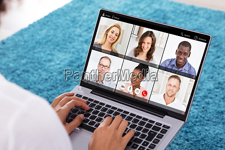 woman video conferencing with doctor on