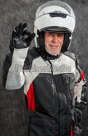 portrait of senior biker with white