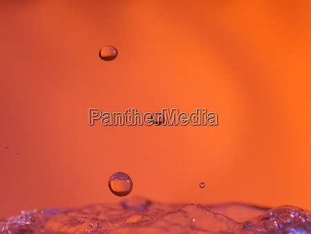 abstract colors colliding drops different fluids