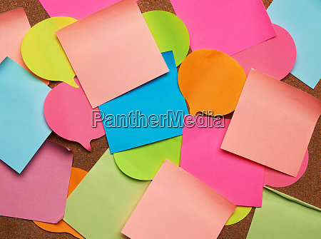 colorful paper stickers glued on brown