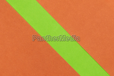 green and orange coloured paper background