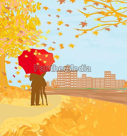 lovers walk on an autumn day