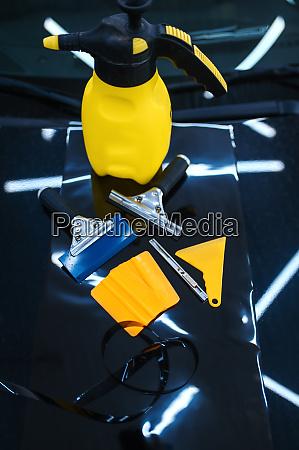 tools for car tinting closeup vehicle