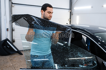 specialist installs wetted car tinting tuning