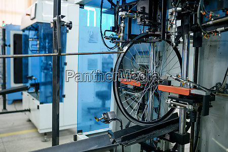 bicycle wheels assembly line spokes installation