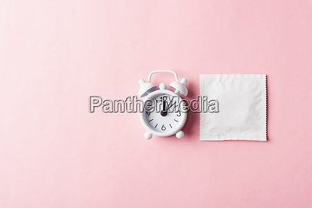 condom in wrapper pack and alarm